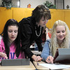 Kelsey Darge (left) and Alyssa Hill get some help from Family and Consumer Science teacher Laurie Hagberg while working with the class's new iPads Wednesday.