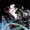 John Cross<br /> A lighted float created by Q Computer that featured Frosty the Snowman and Rudolph the Red-Nosed Reindeer riding a motorcycle was selected Friday as the best entry in the Kiwanis Holiday Lights Parade.