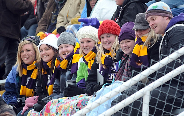 A row of Minnesota State University football fans don matching MSU scarves while trying to fight the cold during the team's NCAA Division II playoff game Saturday at Blakeslee Stadium.