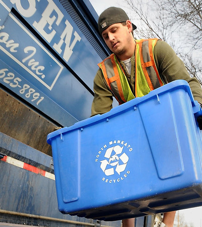 John Cross<br /> Mike Coombe of Hansen Sanitation picks up recycleables along Loray Drive in North Mankato.
