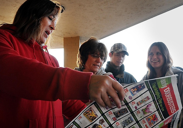 John Cross<br /> Front left, Dawn McCarthy, Mary Olson, Brian Cook and Tonya Lindmark had claimed the first four places in line outside of Shopko on Thursday morning to buy pre-Black Friday bargains.
