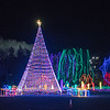 The large Christmas tree in the middle of Sibley Park looms over other decorations at Kiwanis Holiday Lights. This year's holiday lights includes a new 100-foot light tunnel, which doubles last year's of 50 feet. Photo by Jackson Forderer
