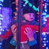 Grayson Sauter, 1, is held up by his grandmother Darci Sauter to get a closer look at the lights in the auto light tunnel during the opening night of the Kiwanis Holiday Lights. This year's tunnel is twice the length of last year's. Photo by Jackson Forderer