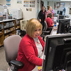 Mary Goodrich (center) and other employees at the Blue Earth County License Center finish their shifts before the start of Thanksgiving break. Staff said they are the busiest at lunch time and at 4 p.m. Photo by Jackson Forderer