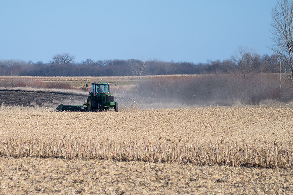 A farmer plows his field in rural St. James on Tuesday. Nearby farmer Harold Wolle noted that American farmers are growing far more food than their countrymen can eat. Photo by Jackson Forderer