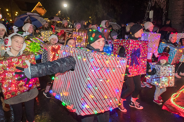 Hannah Linnes (center), 14, dances with other students from Dance Express during the Kiwanis Holiday Lights Parade held at Sibley Park on Friday. Photo by Jackson Forderer