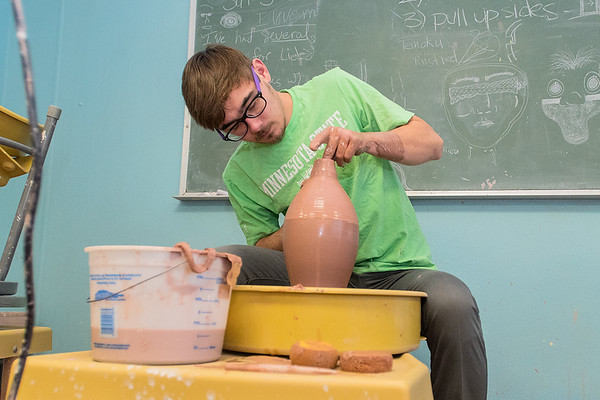 Shawn Bagley throws a vase at the Arts Center of St. Peter on Wednesday. Bagley said he began pottery while attending the Minnesota New Country School five years ago. His pottery show 21 Plus is on display at the Arts Center until Nov. 25. Photo by Jackson Forderer