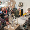 Cindy Sternberg (far right) helps Chelsea Lawrence (second from right) with her purchase as other customers peruse items for sale at Bella Nova Boutique in Old Town in Mankato during Shop Small Saturday. Photo by Jackson Forderer