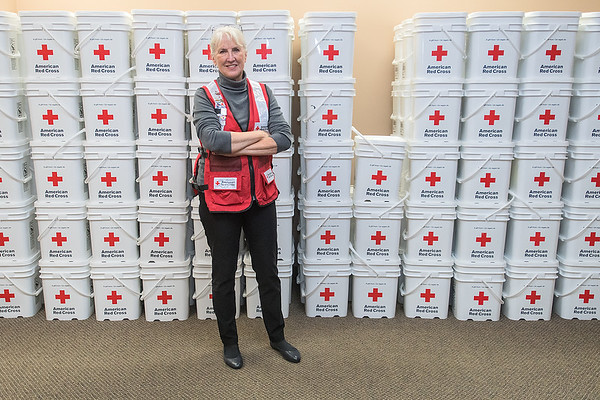 Polly Frank, pictured in front of a wall of rescue buckets, is a volunteer with the American Red Cross and recently was deployed to hurricane affected areas in South Carolina and Florida. It is her eighth year as a volunteer with the Red Cross. Photo by Jackson Forderer