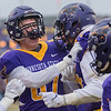 Minnesota State's Cullen Gahagan (second from left) celebrates with Shane Zylstra (second from right) after Zylstra's 52-yard touchdown reception broke a scoreless tie in the second period of Saturday's NCAA Division II playoff game played at Blakeslee Stadium. Photo by Jackson Forderer