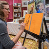 Malia Wiley works on an oil painting of a dog from a submitted picture in her booth Paintings by Malia at the GSR Fine Art Festival held at the Verizon Center on Saturday. Photo by Jackson Forderer