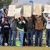 St. Peter fans hold up signs after the girls soccer team defeated Mankato West for the Section 2A championship.