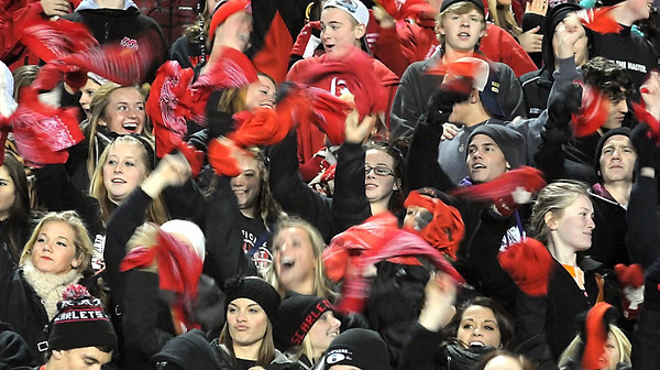 Mankato West football fans wave red hankerchiefsbefore the start of their team's State Class AAAAA quarterfinal game against Owatonna Friday at Lakeville North High School.