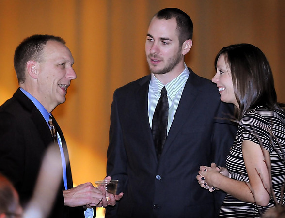 John Cross<br /> Greater Mankato Growth Young Professional award winner Christi Wilking and her husband, Mitch, visit with Steve VanRoekel (left) at the GMG Business Awards Dinner.