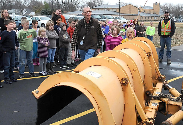 Nicollet County Emergency Management's Windy Block shows Monroe Elementary third-graders how hard it is to see around a snow plow blade by having two girls stand near it Wednesday.