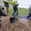 Pat Christman<br /> A group of volunteers rake leaves onto a tarp while raking a Mankato yard Saturday.