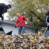 Pat Christman<br /> Students from Bethany Lutheran College rake a yard in Mankato Saturday morning as part of Rake the Town.