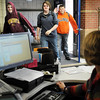 John Cross<br /> St. Peter High School students are greeted by attendance clerk Colleen Bell as they return from an off-campus lunch through the only building door that is unlocked during school hours.