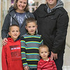 Cherish and Matthew Barker with their sons Sam, 10, Ben, 7 and Jude, 2, at Washington Elementary School. The Barkers were at the school for a literacy program for their sons Sam and Ben. Being involved with the community is important for those moving from larger cities, such as San Diego and Atlanta, where the Barkers have lived before. Photo by Jackson Forderer