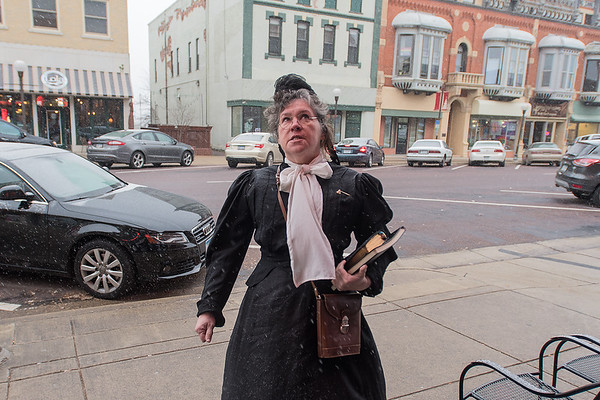 Ellie Carlson, who was portraying Carry Nation, a famous prohibitionist from the early 1900s, acts apprehensive about heading into the B+L Bar in New Ulm to warn people about the dangers of booze and tobacco. Nation visited many bars in the early 1900s, including some in New Ulm. Photo by Jackson Forderer