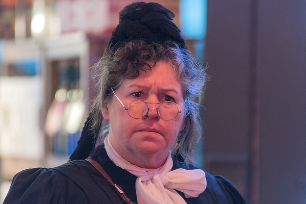 Ellie Carlson, portraying Carry Nation, gives a stern look to some of the patrons at the B+L Bar in New Ulm on Thursday. Carlson's character Nation was a famous prohibitionist who visited bars in New Ulm in 1909. Photo by Jackson Forderer