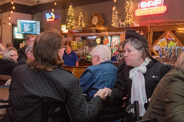 Ellie Carlson, portraying Carry Nation, talks to Ellie Sveine about joining the prohibitionist movement at the B+L bar in New Ulm. Photo by Jackson Forderer