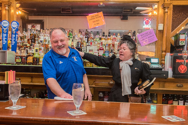 Ellie Carlson, portraying famous prohibitionist Carry Nation, lectures Daryl Roth about the evils of booze at the B+L Bar in New Ulm, just as Nation did in New Ulm in 1909. Photo by Jackson Forderer