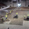 Pat Christman <br /> Workers spread and smooth concrete for a new floor for the Verizon Wireless Center last August.