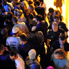 Mankato Public Safety officers make their way through the crowd waiting to enter Red Rocks Saturday night.