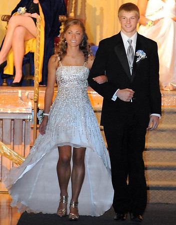 Queen candidate Danielle Vetter escorted by king candidate Brian Baker.