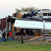 The remainder of a loaded grain truck trailer sits across the tracks after a collision with a westbound train near the Crystal Valley Co-Op elevator along State Highway 14 near Janesville Tuesday evening.