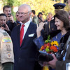King Carl XVI Gustaf and Queen Silvia of Sweden greet onlookers as they make their way toward Christ Chapel during their visit to Gustavus Adolphus College Friday.