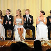 The 2012 Mankato Loyola homecoming royalty applauds during the school's coronation ceremony Wednesday night.