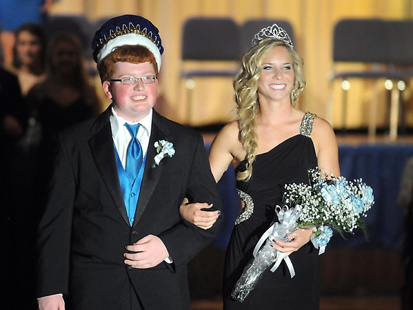 Pat Christman<br /> Loyola Catholic School homecoming queen Aunikah Bastian is escorted by king Ben Torgerson after the school's coronation ceremony Wednesday.