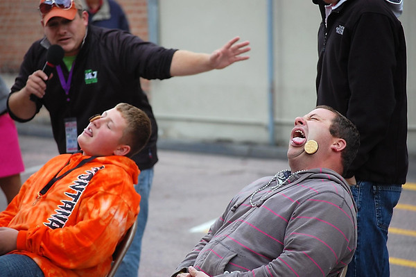 "Josh Moniz<br /> Kyle Paskewitz and his father Tony competed in a ""Beer Olympics"" event Saturday at the New Ulm Oktoberfest celebration in downtown New Ulm."