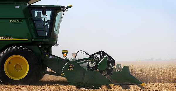 John Cross<br /> Keith Wenner of K & K Farms guides his combine through a soybean field west of St. Peter. Area farmers are just now ramping up for the fall harvest. Last year at this time, after and early planting season, many farmers were nearly done with fall field work.