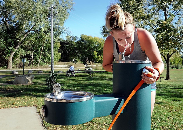 John Cross<br /> Sam Preusser took a break from walking her dog along the Red Jacket Trail to get a drink from a new water fountain that has been installed at Weagel Park near the Blue Earth County Community Farm south of Mankato. An open house and ribbon cutting were held Monday to showcase crops, the fountain and an irrigation system made possible by the digging of a new well at the site earlier this year.