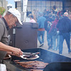 Josh Moniz<br /> A man serves up bratwurst during New Ulm's Oktoberfest Saturday.