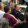 Pat Christman <br /> Snell Motors owner Todd Snell asks a question during a meeting on the construction of roundabouts on Highway 22 in front of his business Thursday at the Snell Motors community room.