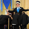 Pat Christman <br /> The other homecoming king candidates bow to 2013 homecoming king Ben Torgerson.