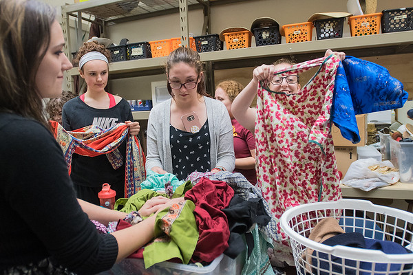 From left, Mystique Deegan, Lauren Senden and Alissa Debill watch Samantha Scholl (right) look at a potential costume for the musical Joseph and the Amazing Technicolor Dreamcoat at the Lincoln Community Center. Photo by Jackson Forderer