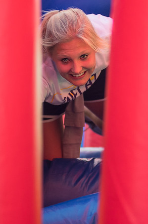 Hailey Eide climbs through an inflated obstacle at the Inflatable 5K hosted by the Student Events Team at Minnesota State University on Saturday. Photo by Jackson Forderer