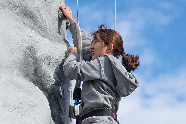 Jihyun Hwang contemplates her next move while climbing the rock wall that was on hand at the finish of the Inflatable 5K held at Minnesota State University on Saturday. Photo by Jackson Forderer