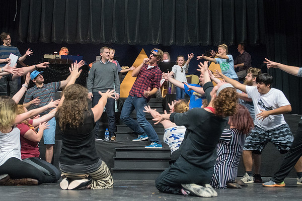 Michael Koester, playing Ramses, is surrounded by his cast mates after performing a number during a rehearsal of the musical Joseph and the Amazing Technicolor Dreamcoat at the Lincoln Community Center. Photo by Jackson Forderer