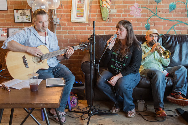 "From left, David Gadberry, Esther Hoffmann and Jameel Haque play at the Coffee Hag on Wednesday. Gadberry, a professor in the music department at Minnesota State University, and others were expecting London-based Aar Maanta and his band, ""The Urban Nomads"" to visit for a week-long residency but they were forced to cancel due to visa delays. Photo by Jackson Forderer"