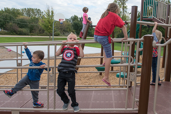 From left, Jace Spillers, 2, Fletcher Byers, 5, Addy Spillers, 4, Brienne Spillers, 6, and Ruby Byers, 7, play on the playground equipment at Southview Park. The City of Mankato is planning to install two new playground in two new city parks. Photo by Jackson Forderer