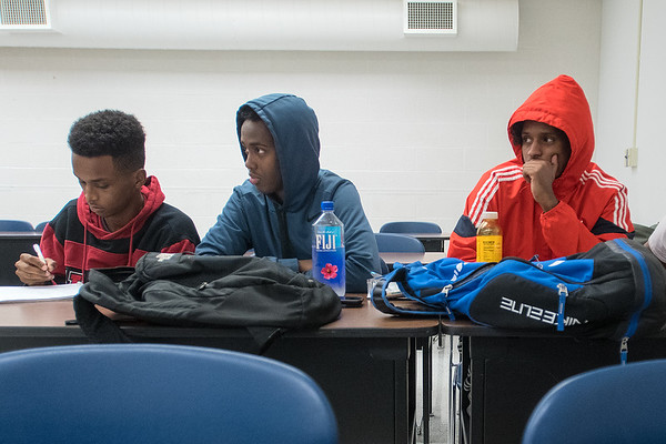 From left, Abdilasis Omar, Mohamed Adam and Ahmed Noor listen to professor Garaad Muse teach a Somali language class at South Central College on Tuesday. Photo by Jackson Forderer