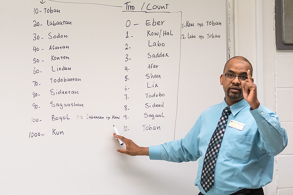 Garaad Muse teaches numbers of the Somali language during a class at South Central College on Tuesday. SCC is the first community college in the state to offer classes for Somali language. Photo by Jackson Forderer