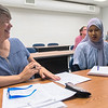 Cheiron McMahill (left), an ESL professor at South Central College, talks with Abader Chano during a Somali language class at the college on Tuesday. Photo by Jackson Forderer