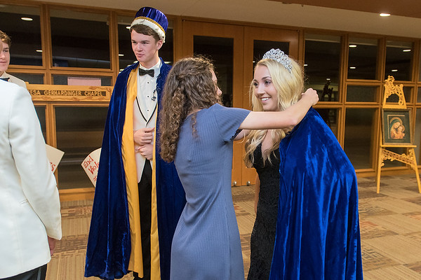 Grace Dehen (right) has her robe adjusted moments after being crowned Mankato Loyola's homecoming queen on Wednesday. Crowned king during the coronation at Loyola was Brendan Kane (at left). Photo by Jackson Forderer
